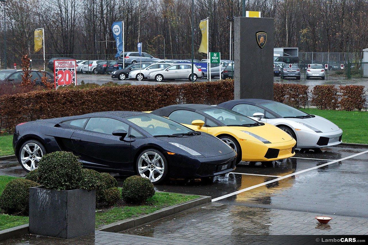 Three Lamborghini Gallardo parked at a dealership