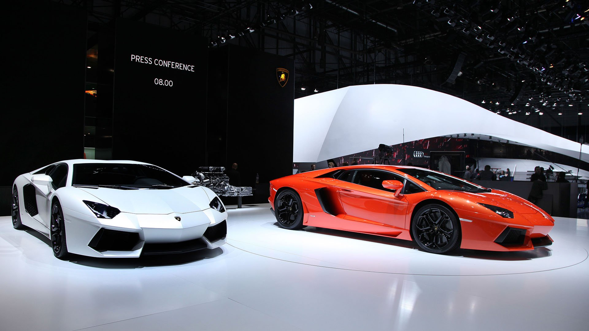 White and orange Lamborghini Aventador at car show